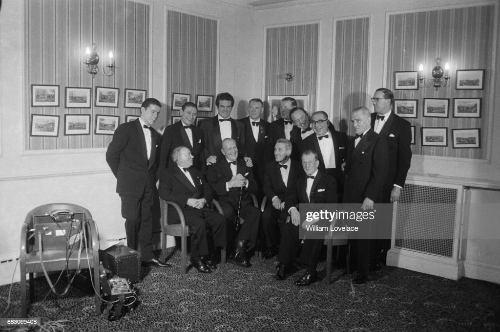 French boxer Georges Carpentier (1894 - 1975), guest of honor at the National Sporting Club Dinner, meets fellow boxers, London, UK, 21st November 1960. (L-R standing): Terry Downs, Harry Mizler, Freddie Mills, Tommy Miligan, Len Harvey, Kid Berg, Alf Mancini, Ted Broadribb and Jack Peterson. (L-R seated): Jimmy Wilde, Bombardier Billy Welis, Georges Carpentier and Joe Wilson.