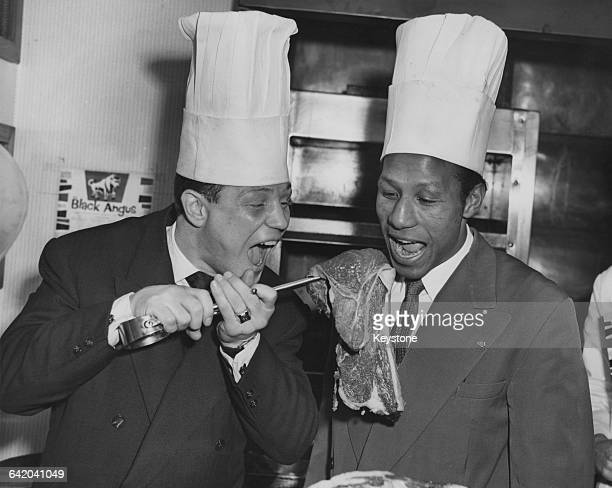 French boxer Gracieux Lamperti the European Boxing Union featherweight champion offers a huge raw steak to Percy Lewis the Commonwealth featherweight...