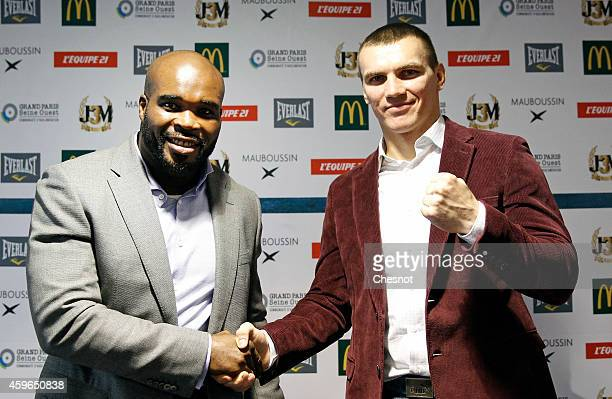 French boxer JeanMarc Mormeck shakes hands with Polish boxer Mateusz Masternak after a press conference on November 27 Issy les Moulineaux France The...