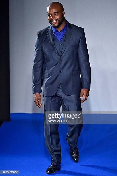 French boxer JeanMarc Mormeck walks the runway during the Agnes B Menswear Fall/Winter 20152016 show as part of Paris Fashion Week on January 25 2015...