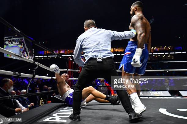 TOPSHOT French boxer Johann Duhaupas fights with French boxer Tony Yoka during the International Heavyweight 12round boxing bout in Nanterre near...