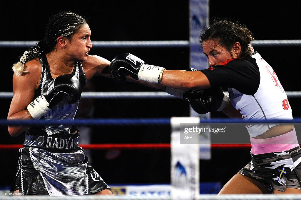 French boxer Nadya Hokmi (L) fights against US boxer Elena Reid during the World Boxing Foundation (WBF) super flyweight championship match on June 5, 2010 in Lingolsheim, eastern France. Hokmi won.