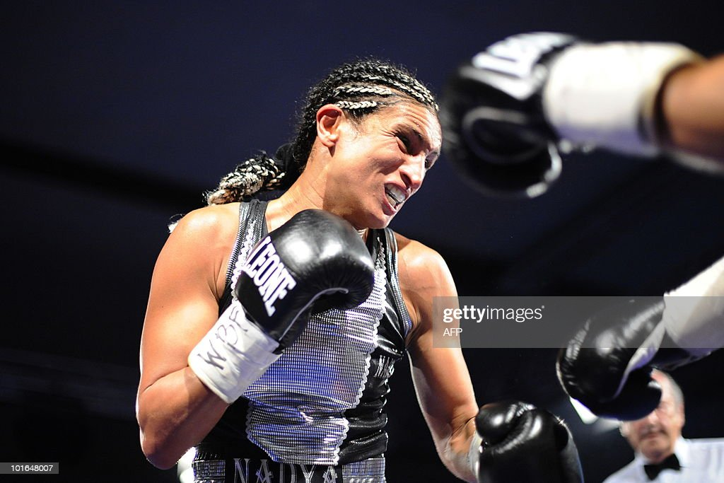 French boxer Nadya Hokmi fights against US boxer Elena Reid during the World Boxing Foundation (WBF) super flyweight championship match on June 5, 2010 in Lingolsheim, eastern France. Hokmi won.
