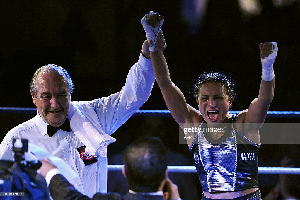 French boxer Nadya Hokmi (R) jubilates after winning her World Boxing Foundation (WBF) super flyweight championship match against US boxer Elena Reid (Not pictured) on June 5, 2010 in Lingolsheim, eastern France.