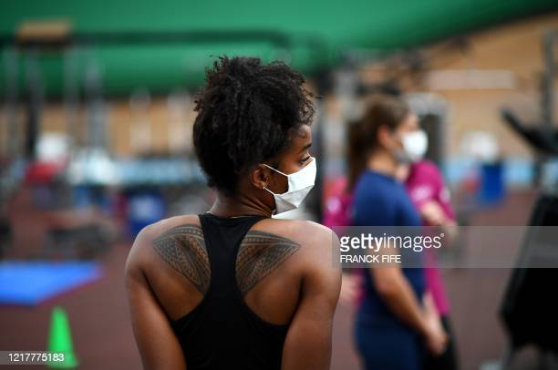A French boxer wearing a protective facemask attends a complete physical evaluation and checkups prior to take part in the first training session at...