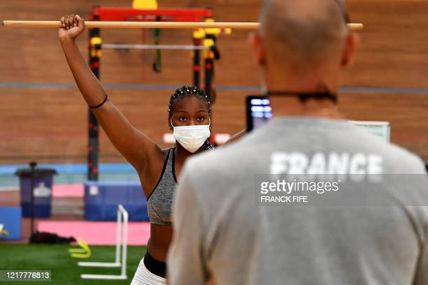 French boxer wearing a protective facemask attends a complete physical evaluation and checkups prior to take part in the first training session at...