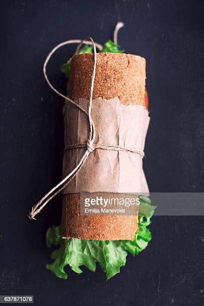 French bread sandwich on black cutting board