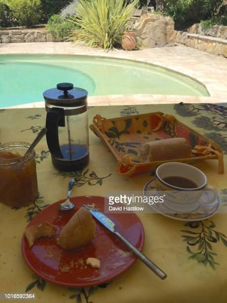 french breakfast of filter coffee brewed in a french press cafeteria and bread - lorgues stock photos and pictures