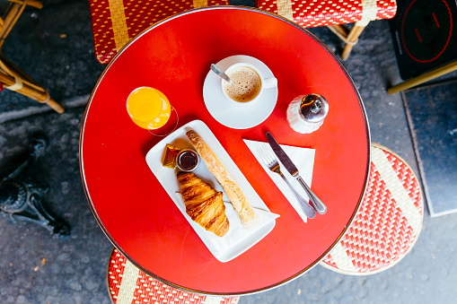 French breakfast with fresh croissant, baguette bread, coffee and orange juice served in cafe, high angle view - gettyimageskorea
