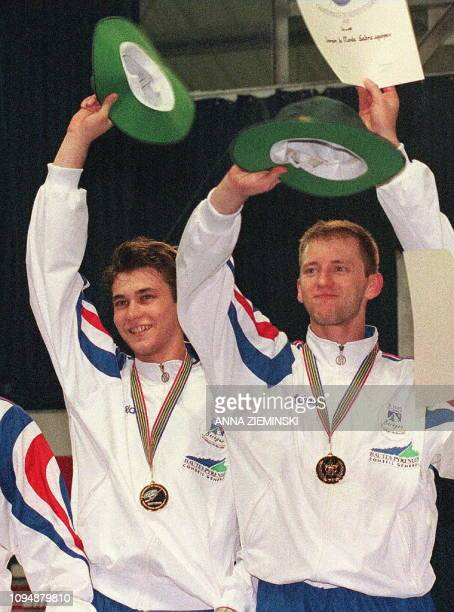 French brothers Damien and Gael Touya celebrate the French Men's Epee Team's victory over the Russians in the final of the Men's Team Epee final at...