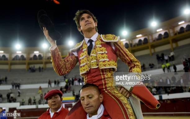 French bullfighter Sebastian Castella celebrates after cutting three ears during a bullfight at La Santamaria bullring in Bogota on February 11 2018...