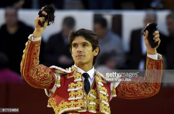 French bullfighter Sebastian Castella holds both ears after a bullfight at La Santamaria bullring in Bogota on February 11 2018 The Colombian...