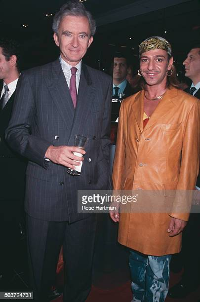French business magnate and Chief Executive Officer of LVMH, Bernard Arnault, and British fashion designer, John Galliano, attend the Sephora store...