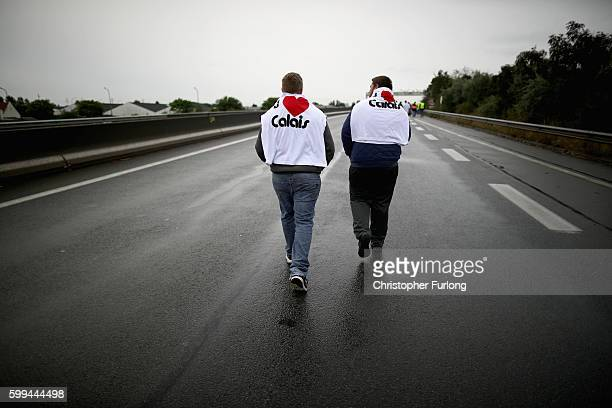 French business owners and locals blockade the main road into the Port of Calais as they wait the arrival of a convoy of trucks protesting against...