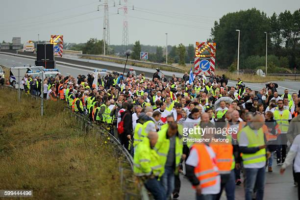 French businesses owners and locals blockade the main road into the Port of Calais as they wait the arrival of a convoy of trucks protesting against...