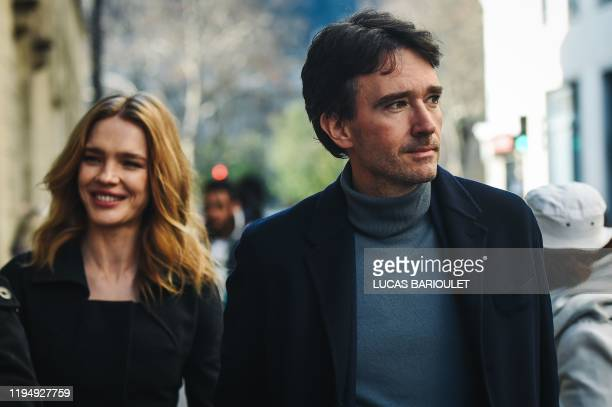French businessman and Bernard Arnault's son Antoine Arnault and his wife Russian model Natalia Vodianova arrive at the Dior Women's SpringSummer...