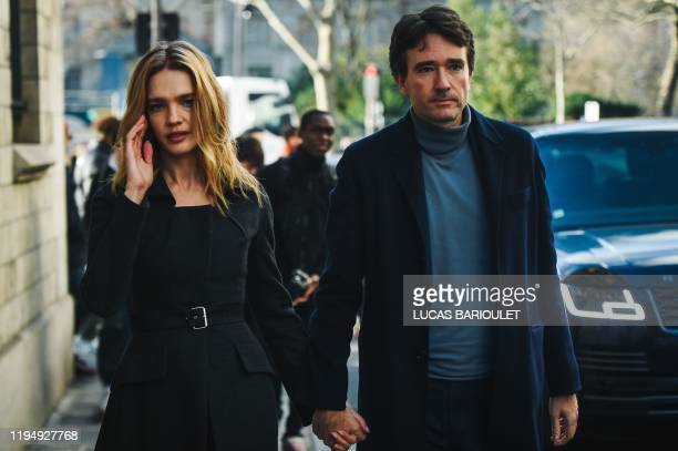 TOPSHOT French businessman and Bernard Arnault's son Antoine Arnault and his wife Russian model Natalia Vodianova arrive at the Dior Women's...