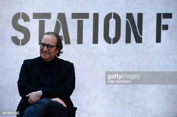 French businessman and founder of startup incubator Station F Xavier Niel attends a press conference at Station F headquarters in Paris on January 17...