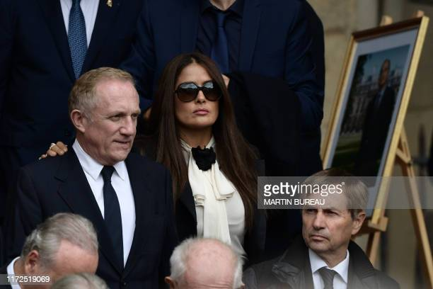 French businessman and Kering chairman Francois-Henri Pinault and his wife Mexican actress Salma Hayek leave after attending a church service for...
