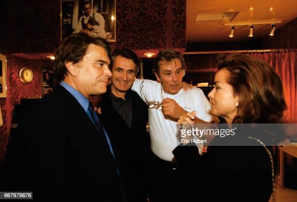 French businessman and politician Bernard Tapie and his wife Dominique congratulate actor Alain Delon backstage at the Theatre de Paris Delon starred...