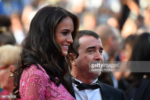 French businessman Arnaud Lagardere and his wife Jade Foret pose as they arrive on May 24 2017 for the screening of the film 'The Beguiled' at the...