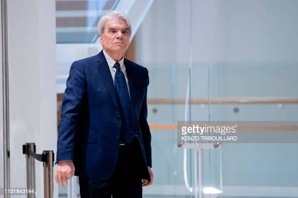 TOPSHOT French businessman Bernard Tapie leaves after a suspension of his trial for having defrauding French state of nearly half a billion euros...