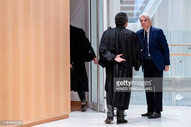French businessman Bernard Tapie leaves after a suspension of his trial for having defrauding French state of nearly half a billion euros with a...
