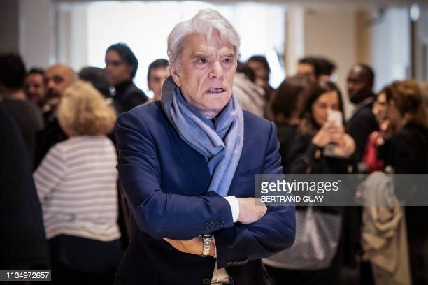 French businessman Bernard Tapie looks on during a suspension of his trial for having defrauding French state of nearly half a billion euros with a...