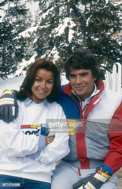 French businessman Bernard Tapie poses with his wife Dominique at the Courchevel ski resort during a presentation of Look skis a new addition to his...