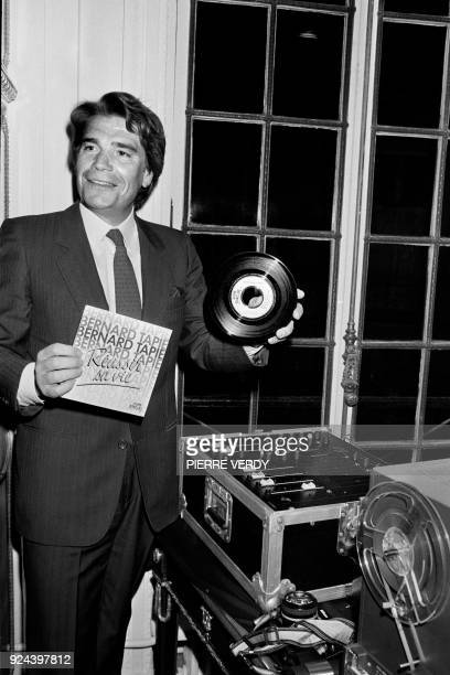 French businessman Bernard Tapie presents his record 'Reussir sa Vie' on January 6 1986 at the fashion House of Madame Grey in Paris