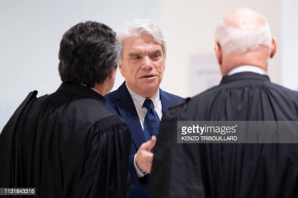 French businessman Bernard Tapie talks to lawyers as he leaves after a suspension of his trial for having defrauding French state of nearly half a...