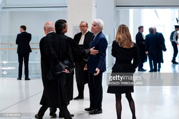 TOPSHOT French businessman Bernard Tapie talks to lawyers as he leaves after a suspension of his trial for having defrauding French state of nearly...