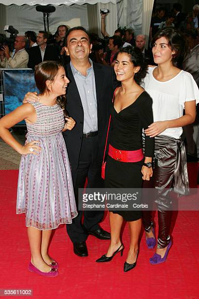 French businessman Carlos Ghosn with his daughters Maya Nadine Caroline at the premiere of Devil Wears Prada during the 32nd American Film Festival...