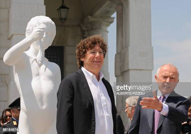 French businessman Francois Pinault and US artist Charles Ray pose near 'The Boy with the frog' by Charles Ray in front of Punta della Dogana in...