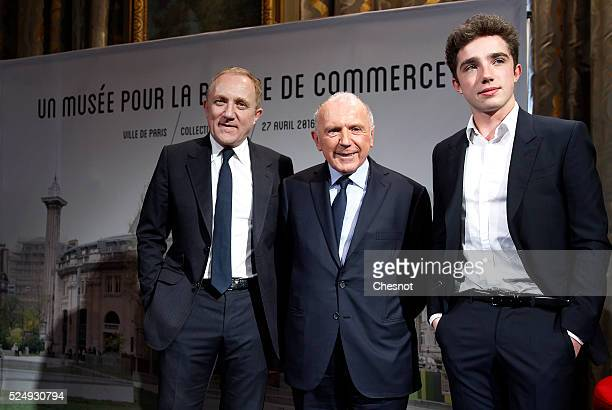 French businessman Francois Pinault poses with his son Francois-Henri Pinault , CEO and Chairman of the board of directors of Kering, and his...