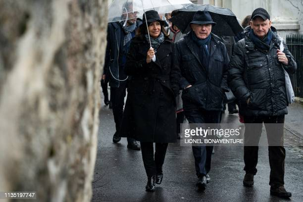 French businessman Francois Pinault , sponsor of the Hauteville House, and mayor of Paris Anne Hidalgo walk in a street of Saint Peter Port, the...