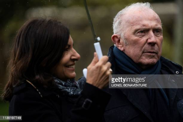 French businessman Francois Pinault , sponsor of the Hauteville House, and mayor of Paris Anne Hidalgo walk in the garden of the Hauteville house...