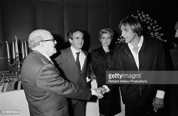 French businessman Marcel Dassault director Francois Truffaut actress Catherine Deneuve and actor Gerard Depardieu during the premiere of the film Le...