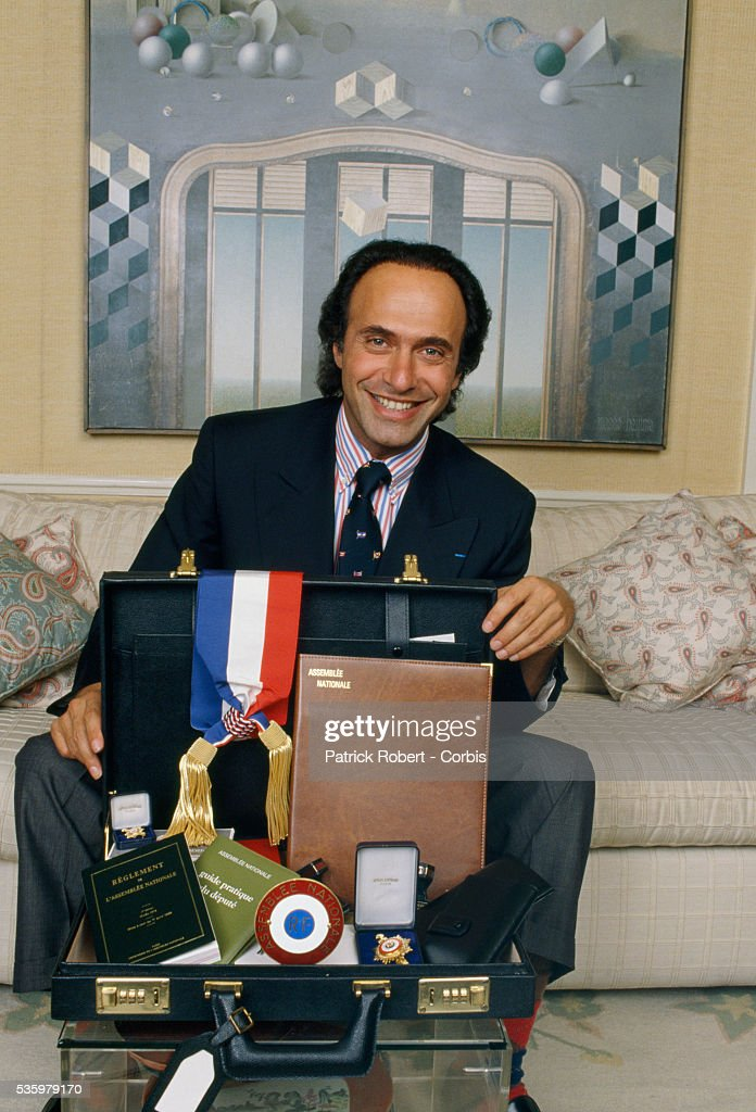 French businessman, politician, and composer Olivier Dassault at home with his deputy's briefcase. Dassault, who owns Dassault Falcon Service, is the grandson of Marcel Dassault, the legendary aviation engineer and manufacturer.