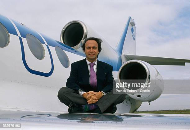 French businessman politician and composer Olivier Dassault sits on the wing of an airplane at Le Bourget Airport Dassault who owns Dassault Falcon...