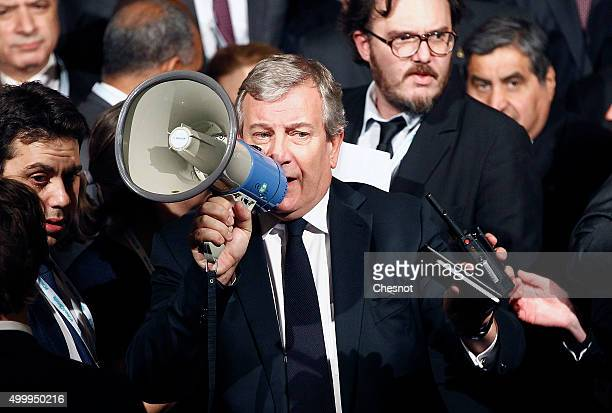 French businessman Richard Attias speaks with a megaphone during the Summit of Local elected for Climate at the Paris city hall on December 04 2015...