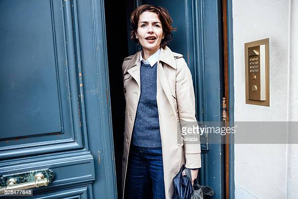 french businesswoman standing at the door