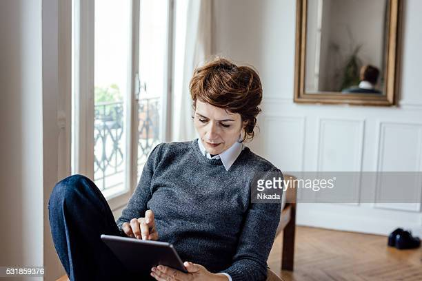 french businesswoman using a tablet