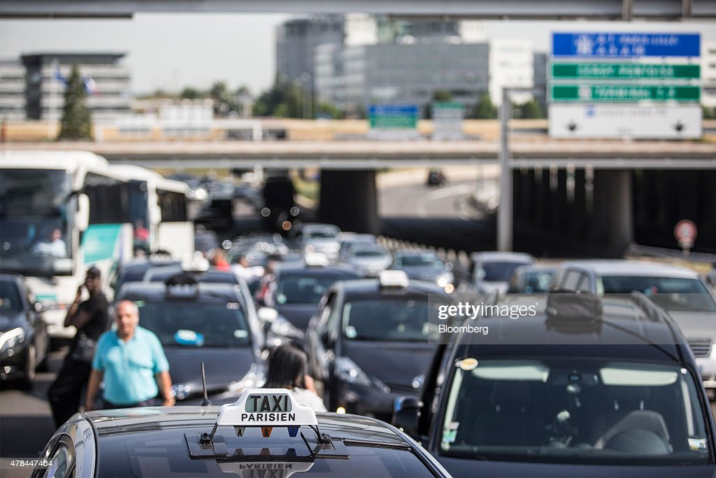 French cab drivers block roads outside Charles de Gaulle airport during a protest against Uber Technologies Inc.'s car sharing service in Roissy, France, on Thursday, June 25, 2015. French taxi drivers are on indefinite nationwide strike as they demand a government crackdown on what they say is Uber's use of unlicensed chauffeurs for its UberPop service. Photographer Balint Porneczi/Bloomberg via Getty Images