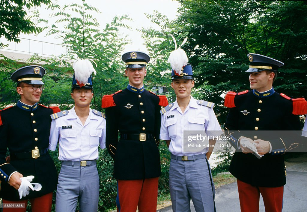 French cadets from Ecole Speciale Militaire de Saint-Cyr, or the St.-Cyr Military Academy, swap hats with their new friends at the Korea Military Academy in Seoul.