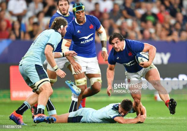 French Camille Chat vies with Scottish Ben Toolis and Adam Hastings during the 2019 Rugby World Cup warmup test match between France and Scotland at...