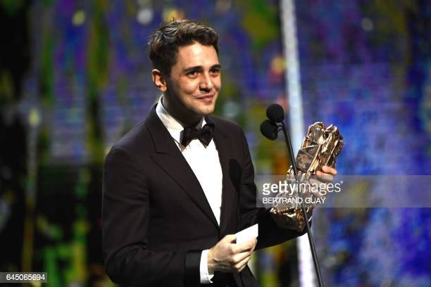 French Canadian actor and film director Xavier Dolan speaks on stage with the Best Actor award won by French actor Gaspard Ulliel for 'Juste la fin...