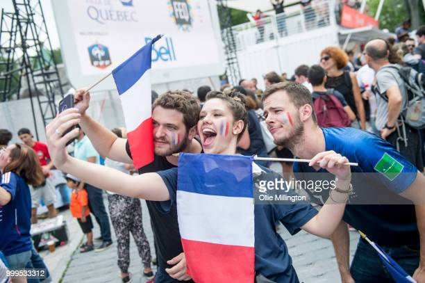 French Canadian football fans react as France win the Russia 2018 World Cup final football match against Croatia outside the Quebec Parliment...