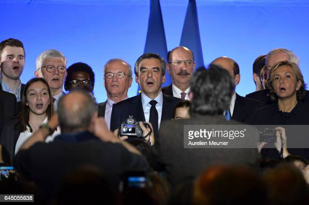 French candidate for the rightwing 'Les Republicains' Party Francois Fillon sings the National Anthem after a political meeting on February 24 2017...