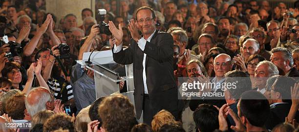 French candidate for the socialist nomination for next year's presidential vote and former socialist party leader François Hollande waves at the end...